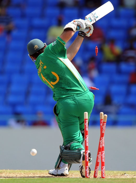 South African captian Graeme Smith is clean bowled off West Indies bowler Jerome Taylor. Smith made 15runs. (AFP PHOTO)