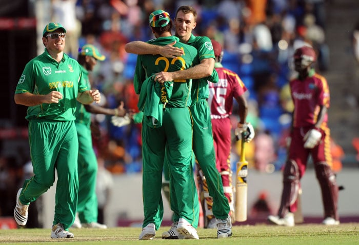 South African cricketers celebrate their victory at the end of the second T20 match against West Indies. Johan Botha was declared the man of the match. (AFP PHOTO)