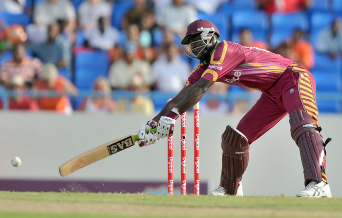 West Indies batsman Darren Sammy plays a shot during the second innings of the match against South Africa. Sammy made 17 runs. (AFP PHOTO)