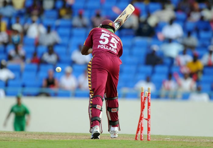 West Indies cricketer Kieron Pollard is clean bowled off South African bowler Ryan McLaren.Mclaren finished with figures of 5/19. (AFP PHOTO)