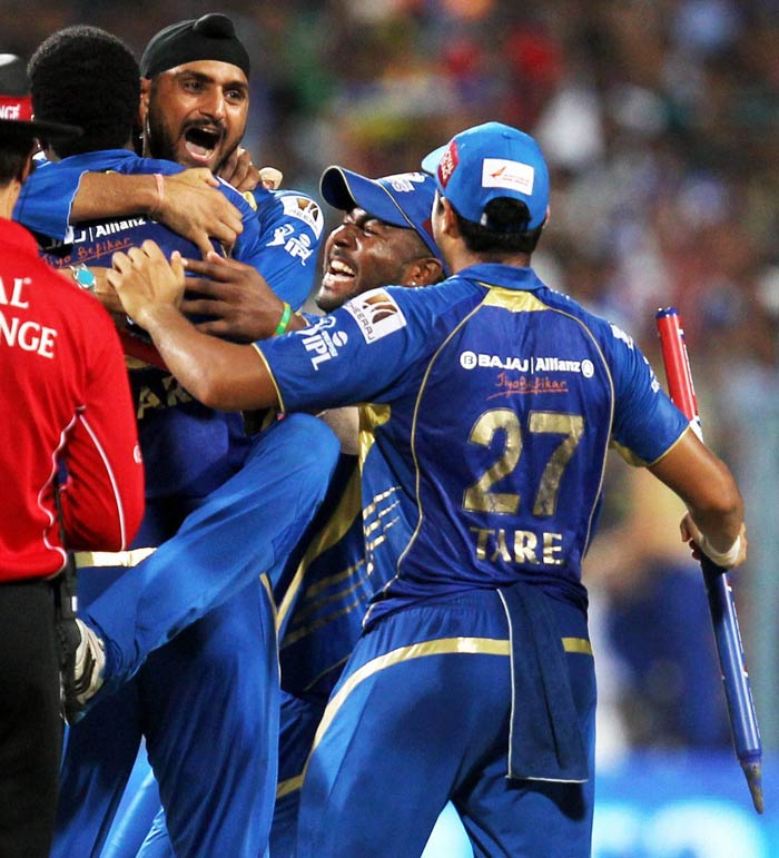 Harbhajan Singh is seen here leaping on Kieron Pollard in celebrations after the match was won. (PTI image)