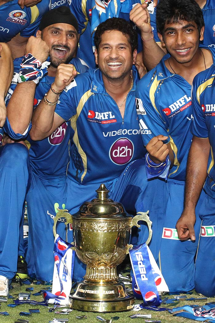 There was no limit to Mumbai Indians' jubilant celebrations after the team defeated Chennai Super Kings to win their maiden IPL title.<br><br>That a veteran teammate announced his IPL retirement was another reason to pump up the decibels and give Sachin Tendulkar a memorable farewell. A look...(BCCI image)
