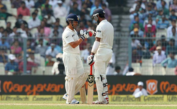 He lost partner Cheteshwar Pujara (right) soon after but managed to anchor the innings for a brief period.