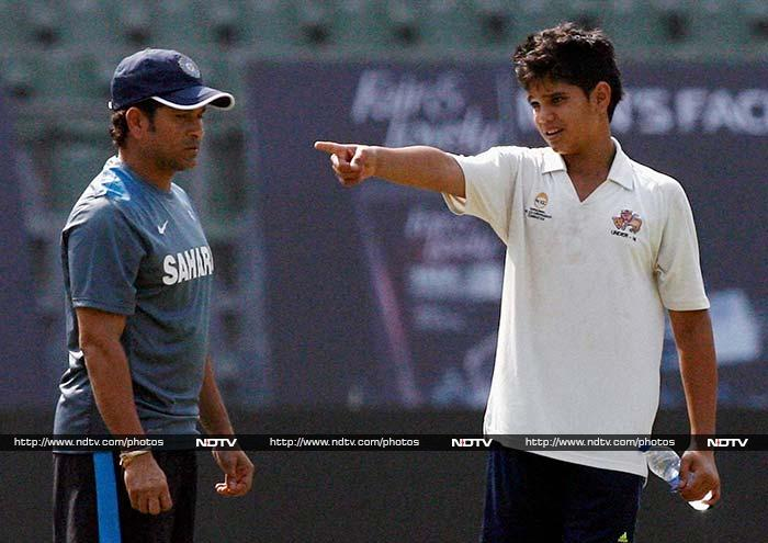 Known to be as passionate about cricket as his father continues to be at 40, Arjun joined legendary cricketer Sachin Tendulkar on the Wankhede field as Team India began training for the second match vs West Indies - Sachin's 200th and final appearance. <br><br>Images courtesy: PTI