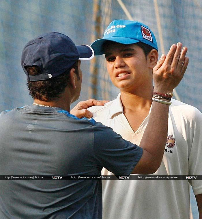 Grooming the next Tendulkar in the team?<br><br>Arjun seems to be getting some valuable tips from his father.