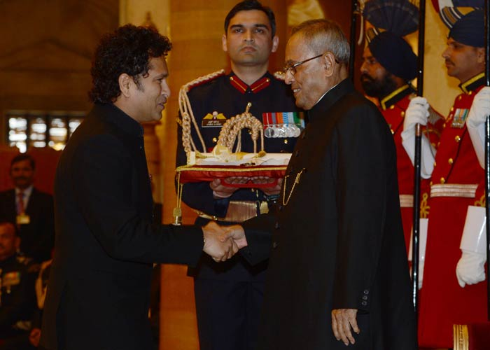 """Sachin Tendulkar was greeted by President Pranab Mukherjee. <br><br>The veteran of 200 Tests and 463 ODIs was honoured for his contribution to Indian cricket. <br><br> """"This is the greatest honour of my life. I am so proud to have been born in India and I will continue to bat for the country,"""" he told reporters later."""