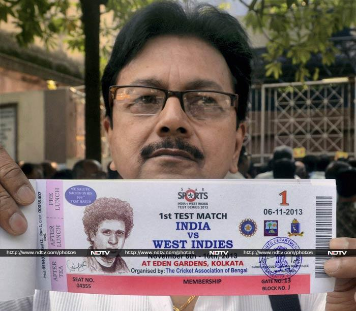 And the lucky fans are flaunting their tickets - with image of Sachin printed boldly to reveal the height of frenzy.