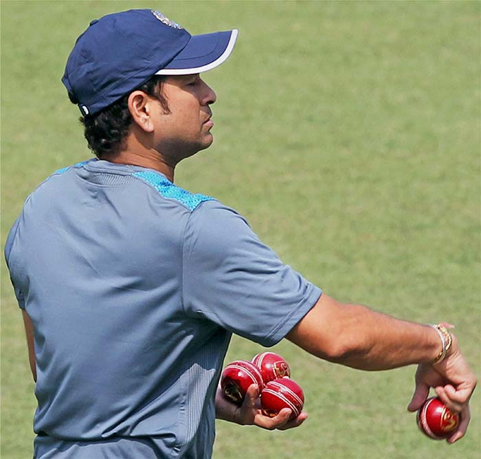 Sachin prepares to give a few throw-downs as he juggles the ball at the Eden Gardens, Kolkata on Monday.
