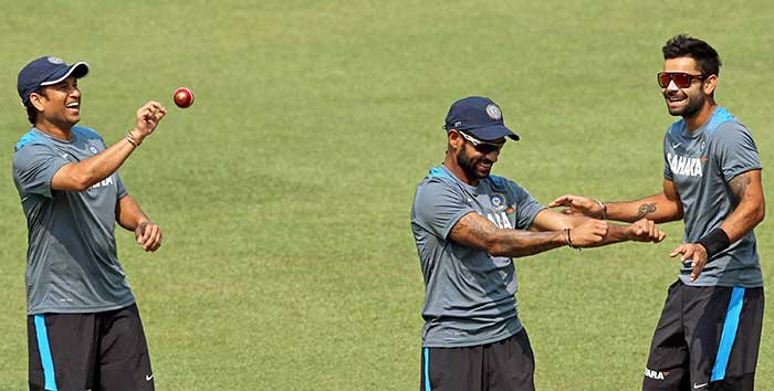 Sachin (left) spins the ball in his hand during the training session at the Eden Gardens. Will we see him bowl for one final time in Kolkata?