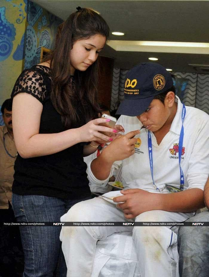 First up, Arjun and Sara Tendulkar were seen enjoying themselves as an entire stadium cheered their father on the ground.