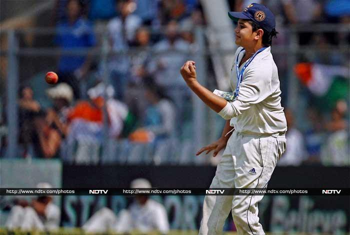 Even the high-profile spectators were seen cheering Tendulkar Sr. but the loudest cheer was perhaps when Arjun - ball boy for the match - jumped into action from beyond the boundary ropes.