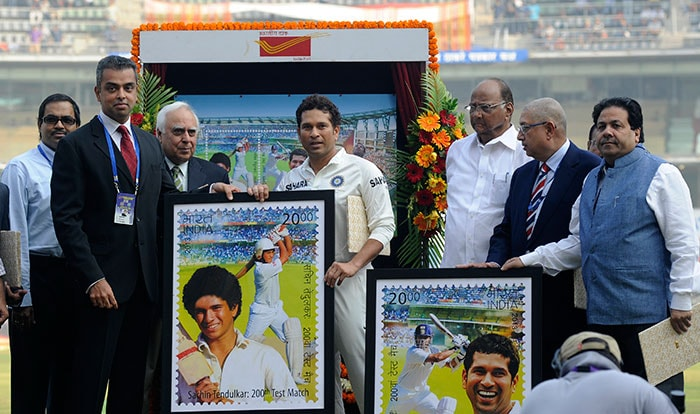 Sachin Tendulkar of India poses with the framed versions of the stamp produced in his honour.