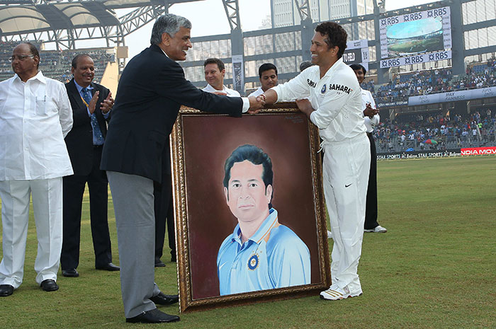 The veteran cricketer receives a portrait to celebrate his 200th Test.