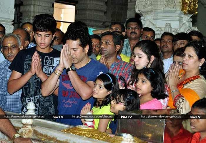 Sachin, along with his son Arjun and daughter Sara, prays at the famous Somnath Temple on Saturday, March 22, 2014.