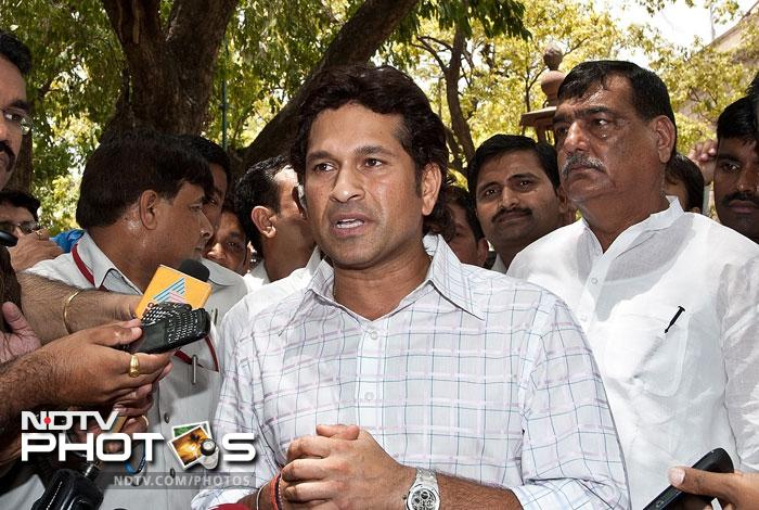 """Sachin Tendulkar, who sworn in as a nominated member of the Rajya Sabha, said he would like to help other sports but he will not take his focus away from cricket. Speaking to media he said, """"In the last 22 years of my international career, cricket has given me so much and I also wanted to give something back to cricket in the latter half of my life. Today with the nomination, I am in a better position not only to help cricket but also other sports."""" (AFP Photo)"""
