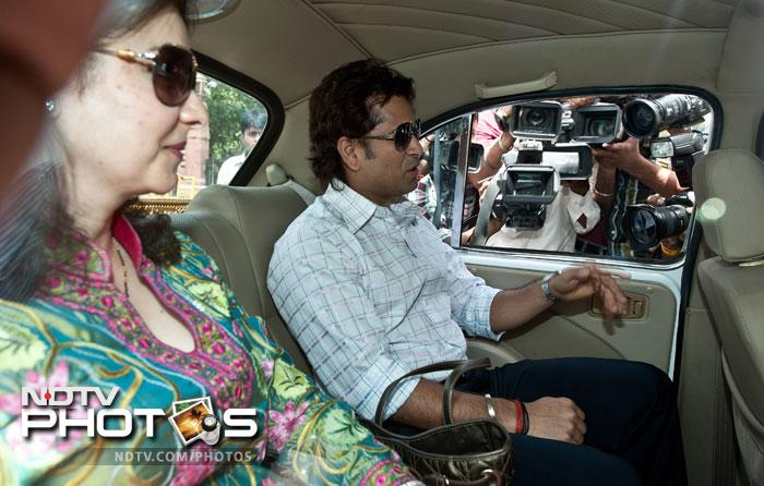 Sachin arrived in New Delhi with wife Anjali to formally start his new innings. He could not take oath in May along with veteran actress Rekha and industrialist Anu Aga after being nominated to the Upper House in April because of his IPL commitments. (AFP Photo)