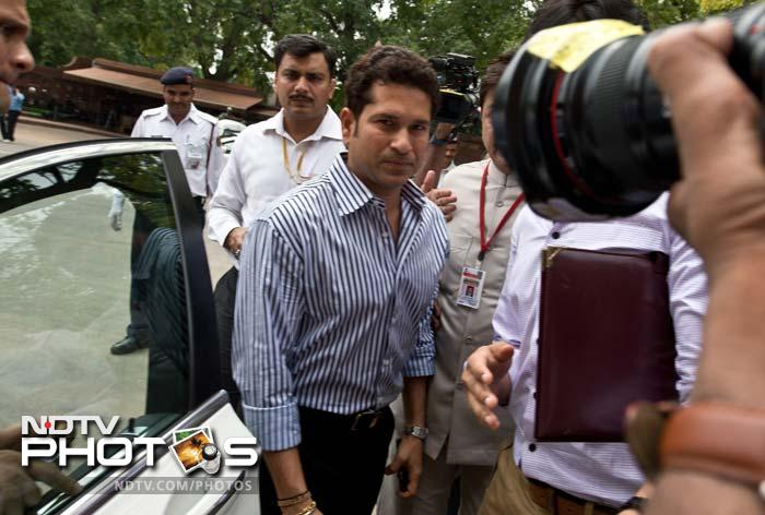 Wearing blue striped shirt and black trousers, Tendulkar walked in with minister of state for parliamentary affairs Rajeev Shukla. (AFP image)
