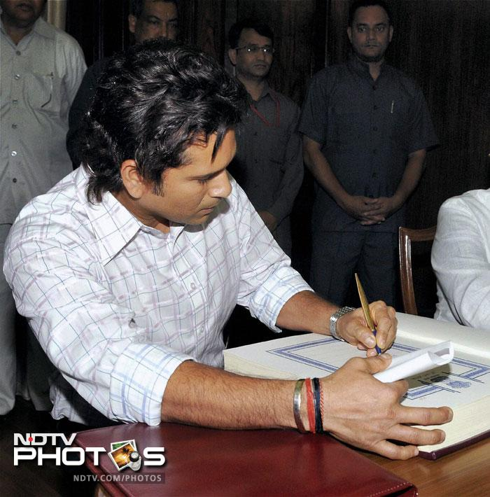 Sachin Tendulkar, after garnering many laurels in cricket, penning his way to national glory. President Pratibha Patil had approved the cricket legend's name along with Bollywood actor Rekha and businesswoman Anu Aga in April for the Upper House of the Parliament. The approval had come after Prime Minister Manmohan Singh wrote to the President with the government's recommendations. (PTI Photo)