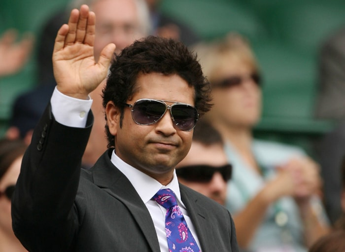 Indian cricketer Sachin Ramesh Tendulkar acknowledges the crowd ahead of play between US Serena Williams and Slovakia's Dominika Cibulkova during the Wimbledon Tennis Championships at the All England Tennis Club in southwest London. (AFP Photo)