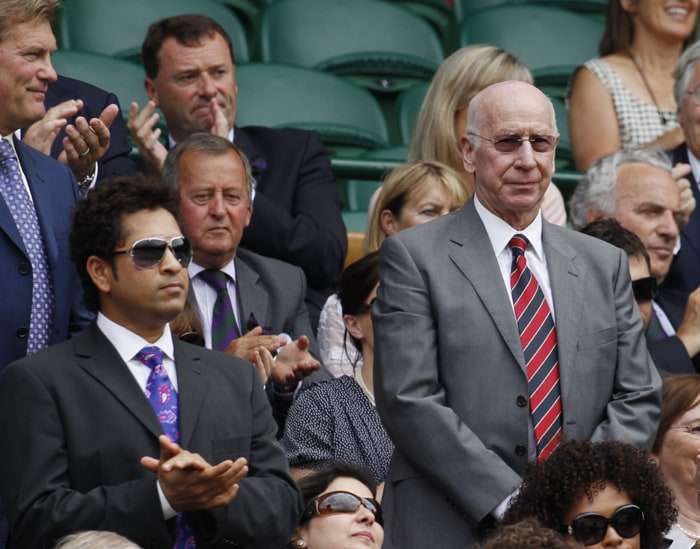 Former England football player Bobby Charlton right and Indian cricketer Sachin Tendulkar are introduced to the crowd on Centre Court at the All England Lawn Tennis Championships at Wimbledon. (AP Photo)