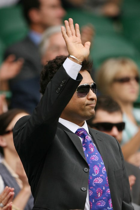 Sachin Tendulkar acknowledges the crowd ahead of play between Serena Williams and Dominika Cibulkova during the Wimbledon Tennis Championships at the All England Tennis Club in London. (AFP Photo)