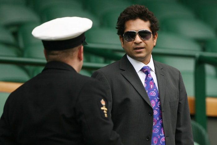 Sachin Tendulkar attends a tennis match between Serena Williams and Dominika Cibulkova during the Wimbledon Tennis Championships at the All England Tennis Club in London. (AFP Photo)