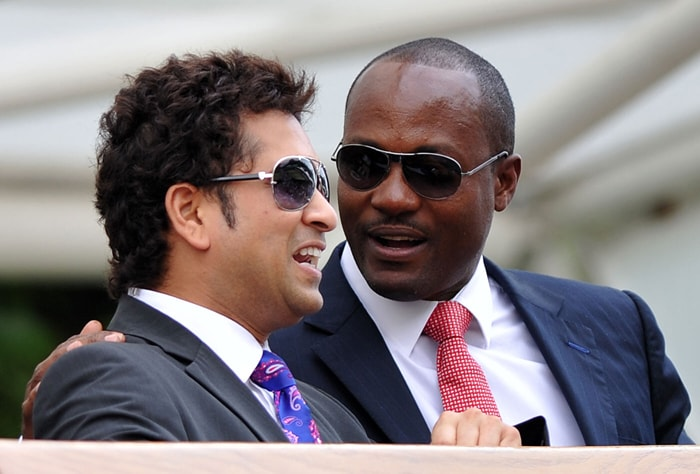 Sachin Tendulkar talks with former West Indian cricketer Brian Lara during the sixth day of the 2010 Wimbledon Tennis Championships at the All England Tennis Club in south-west London. (AFP Photo)