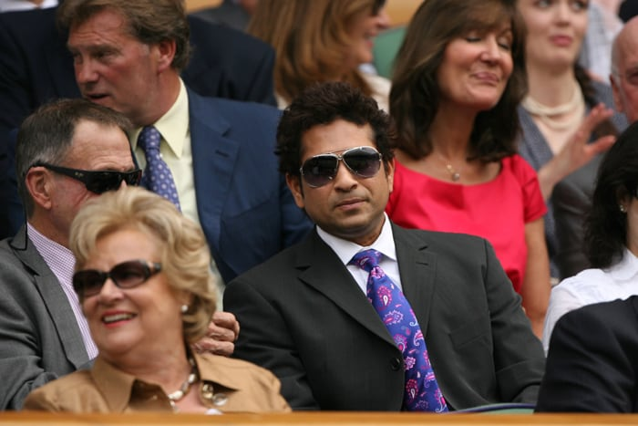 Sachin Ramesh Tendulkar attends a tennis match between Serena Williams and Slovakia's Dominika Cibulkova during the Wimbledon Tennis Championships at the All England Tennis Club in London. (AFP Photo)