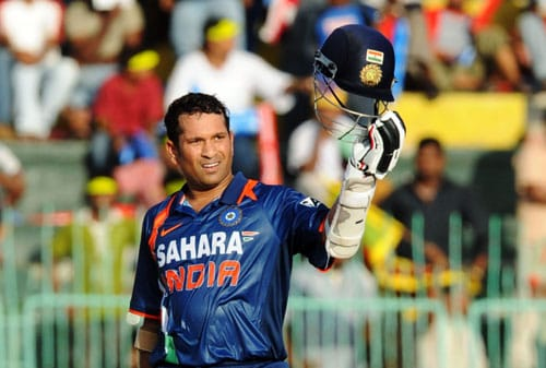Indian batsman Sachin Tendulkar raises his helmet in the air to celebrate scoring a century, which was his 44th ODI, during the Compaq Cup tri-series final match against Sri Lanka at The R. Premadasa Stadium in Colombo on September 14, 2009. (AFP Photo)
