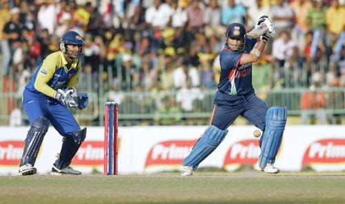 Sri Lanka's team captain Kumar Sangakkara takes his position as India's Sachin Tendulkar plays a shot during their final tri-nation series in Colombo. (AP Photo)