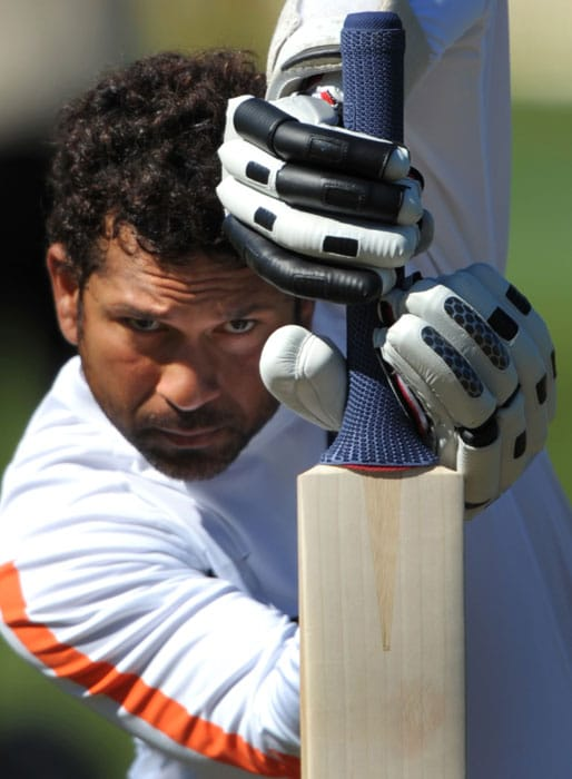 <b>A gritty Sachin.</b><br><br>His eyes unwavering, Sachin looks head on at his target. (AFP Photo)
