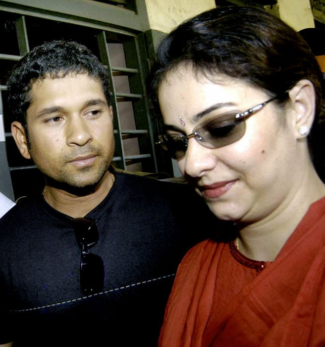 <b>You're the apple of my eye!</b><br><br>Sachin - the doting husband, with wife Anjali. (AFP Photo)