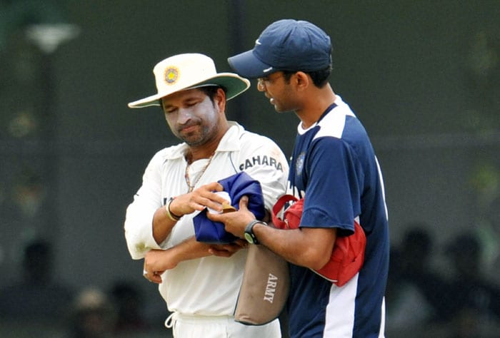 <b>The wounded tiger</b><br><br>Sachin's tennis elbow gave him a lot of pain but more so, gave him more determination. (AFP Photo)