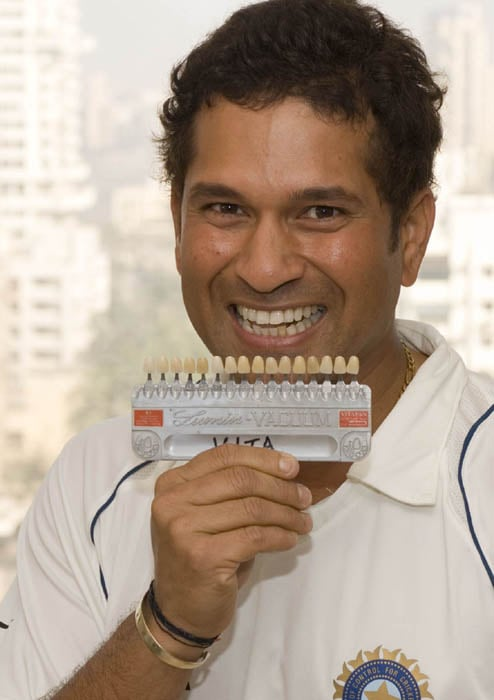 <b>All smiles..</b><br><br>Sachin giving his measurements for his wax statue that was installed at Madam Tussauds Museum in London.