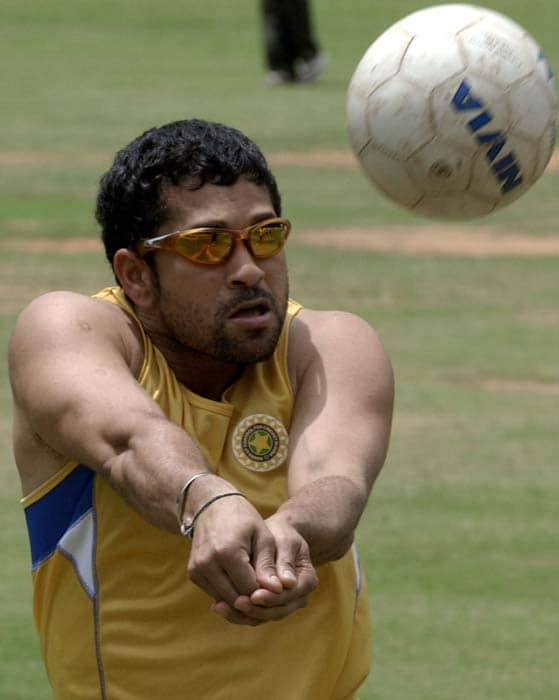<b>It's a different ball game</b><br><br>Sachin playing volleyball. (AFP Photo)