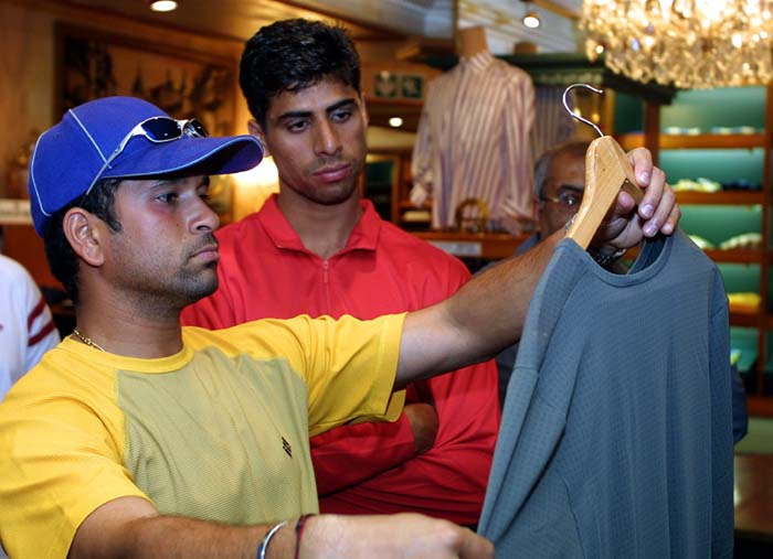 <b>Shop till I drop!</b><br><br>Not quite! He'd spend more hours on the field than in a mall!<br><br>Captured here choosing the right fit. (AFP Photo)