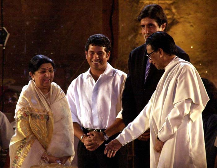 <b>Modesty = Sachin</b><br><br>A humble Sachin Tendulkar surrounded by stalwarts at a function. (AFP Photo)
