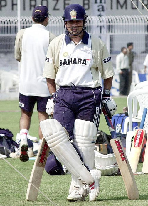 <b>One ain't enough!</b><br><br>Sachin with his favourite weapon. (AFP Photo)