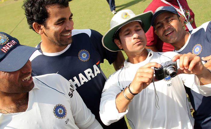 <b>Capturing the winning moments..</b><br><br>Sachin turns photographer as he captures the winning moments of the team. (AFP Photo)