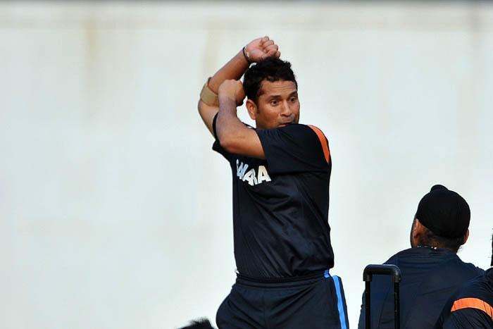 <b>An animated Tendlya</b><br><br>Sachin goes dramatic as he gestures towards Harbhajan Singh. (AFP Photo)