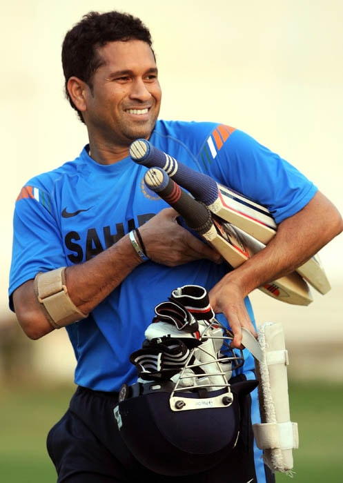 <b>Master's precious assets!</b><br><br>Sachin with his prized possessions! (AFP Photo)