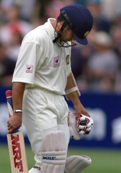 <b>Its not over yet..</b><br><br>A disappointed Sachin who wouldn't give up that easy. (AFP Photo)
