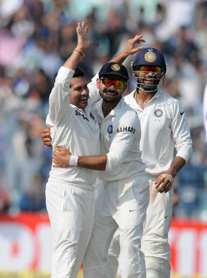 Eden Gardens erupted in joyous celebrations as teammates rushed to Tendulkar to congratulate him on his 201st international wicket.