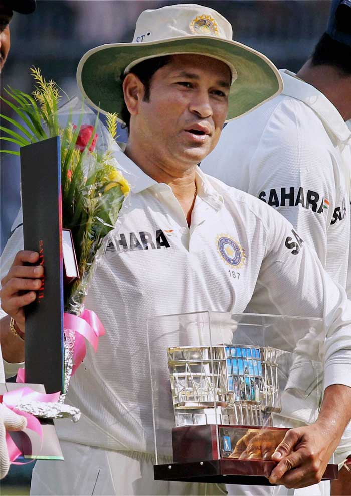 Tendulkar is seen here acknowledging fans and camerapersons.<br><br>Image courtesy: PTI