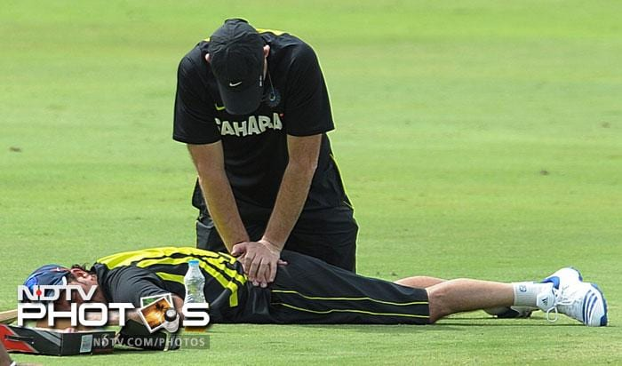 Routine:<br><br>Tendulkar gets treatment from a physiotherapist during the training session.