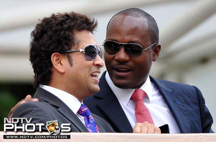 From one legend to another. Tendulkar (L) chats with West Indian cricketer Brian Lara, who was also at the All England Club on the same day at Wimbledon 2010.
