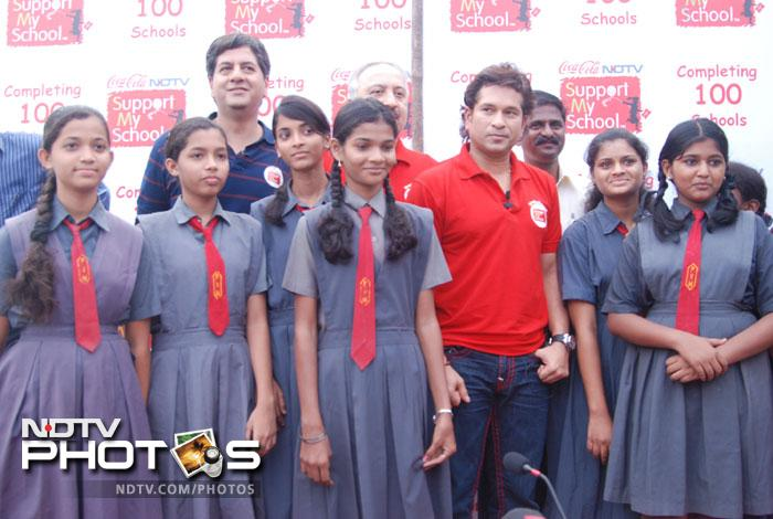 When Sachin Tendulkar walks out on the field, fans hold their breath in awe. On Friday, it was the reverse as the veteran cricketer celebrated 100 schools being included in the NDTV Coca Cola 'Support My School' campaign.<br><br>School girls gather around the Master Blaster as they celebrate the occasion of 100 schools being included in the campaign. (Photo by Milind Shelte)