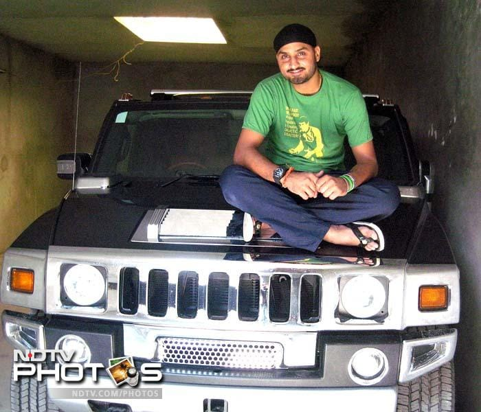 <b>Harbhajan Singh:</b> Quite like captain Dhoni, Harbhajan also has and loves the Hummer that he imported from England in 2009.