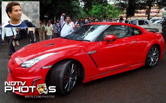 Here's a look at Sachin Tendulkar's latest purchase, a red Nissan GT-R, that has replaced the Ferrari 360 Modena in the batsman's garage. The Ferrari that was presented to him by none other than 7 time F1 champion Michael Schumacher on behalf of the Italian car maker after the master blaster equalled Don Bradman's 29 Test centuries, was recently sold by Sachin to a Surat based businessman. Although Sachin owns a fleet of cars, this is his most famous one.<br><br> We take a look at some of the other cricketers prized possessions.