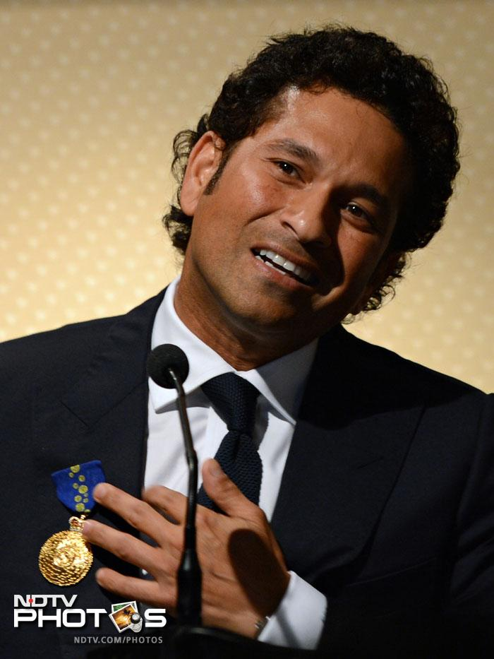 Sachin Tendulkar acknowledges the reception on receiving the Order of Australia in Mumbai.
